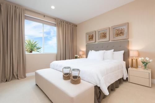 A bed or beds in a room at Magic Village Yards Trademark Collection by Wyndham