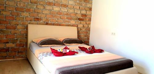 Кровать или кровати в номере Apartments Ana