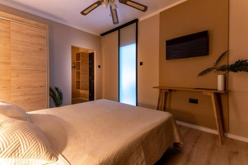 A bed or beds in a room at Villa Maimare