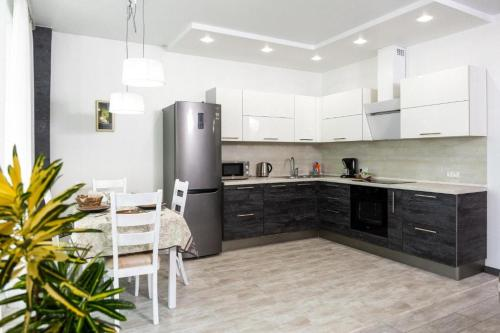 A kitchen or kitchenette at Studio Apartment with Fantastic view in Center