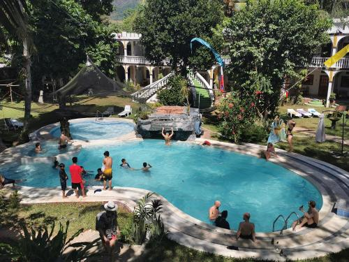 The swimming pool at or near Kokosnuss Garden Resort