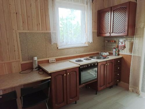 A kitchen or kitchenette at Bonjour Anapa