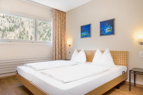 A bed or beds in a room at Hapimag Ferienwohnungen Interlaken