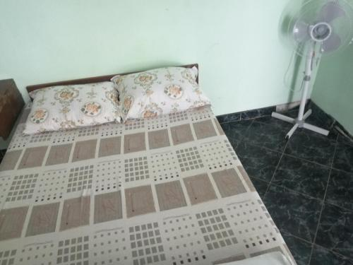 A bed or beds in a room at Бунгала котвата