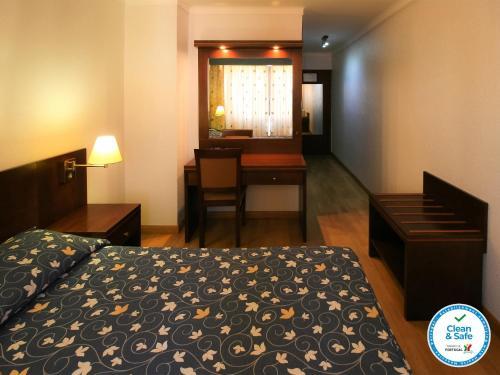 Un ou plusieurs lits dans un hébergement de l'établissement Albergaria Quim Barreiros
