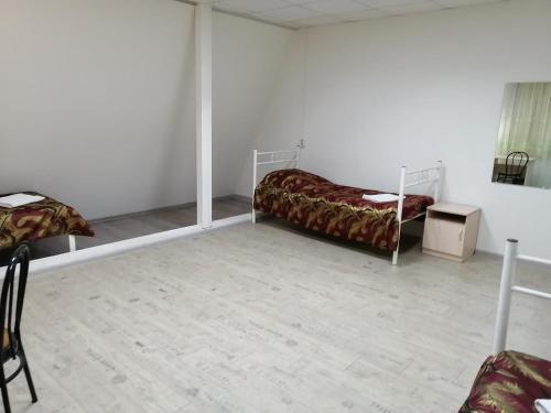 Кровать или кровати в номере Mini Hotel Hosteliya