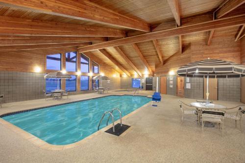 The swimming pool at or near AmericInn by Wyndham Sayre