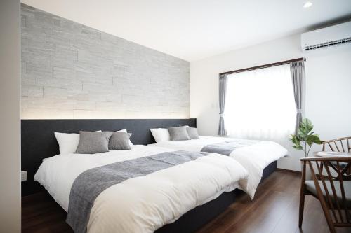 Katil atau katil-katil dalam bilik di SENT RESORT VILLA 宮古島 mp1