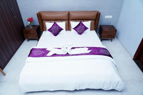 A bed or beds in a room at Unnathi Comfort Inn