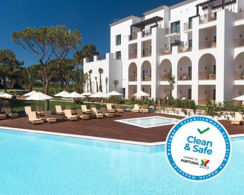 The swimming pool at or near Pine Cliffs Ocean Suites, a Luxury Collection Resort & Spa, Algarve