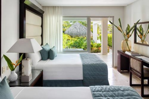 A bed or beds in a room at The Reserve at Paradisus Palma Real - All Inclusive
