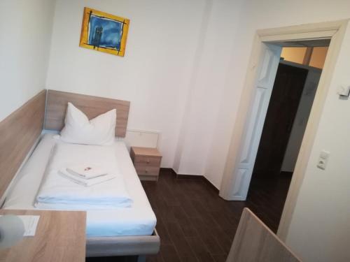 Ein Bett oder Betten in einem Zimmer der Unterkunft Kulturzentrum Sturmmühle