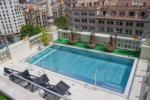 The swimming pool at or near El Avenida Palace