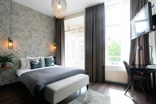 Cama ou camas em um quarto em Quentin Amsterdam Hotel