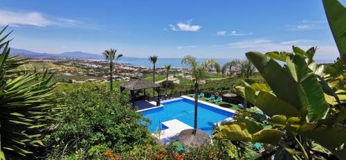 Vista de la piscina de Apartamentos Manilva Green o alrededores