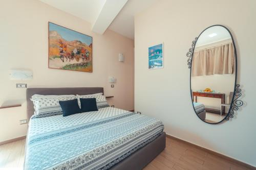 A bed or beds in a room at B&B Floridia