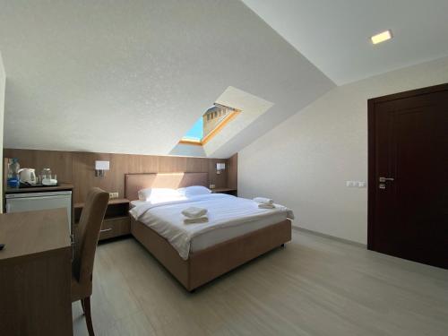 A bed or beds in a room at El verano