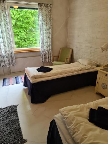 Säng eller sängar i ett rum på Saltvik Bed & Breakfast
