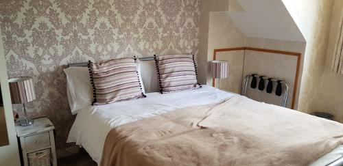 A bed or beds in a room at Coire Glas Guest House