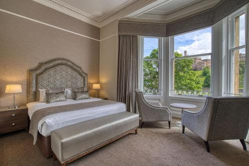 A bed or beds in a room at Best Western Inverness Palace Hotel & Spa