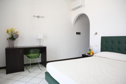 Letto o letti in una camera di La Zagara Hotel