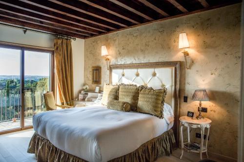 Cama o camas de una habitación en Hotel Boutique Cigarral de las Mercedes