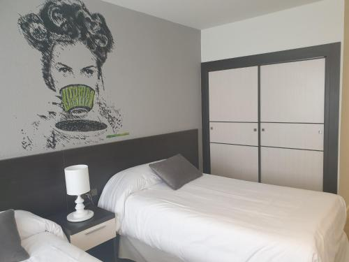 A bed or beds in a room at Hotel Arts - Gasteiz Centro