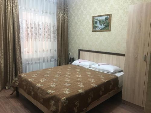 Кровать или кровати в номере Александра Гостевой дом