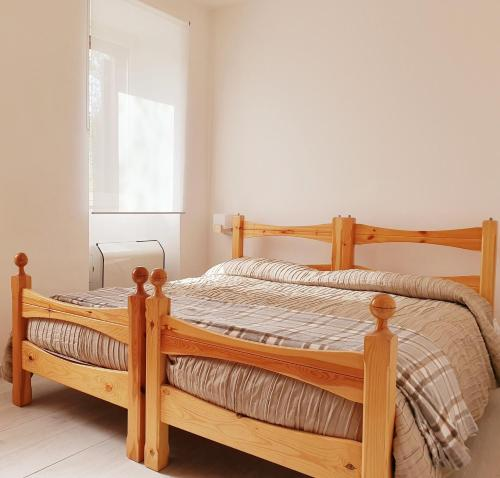 Letto o letti in una camera di Residence Serra La Nave