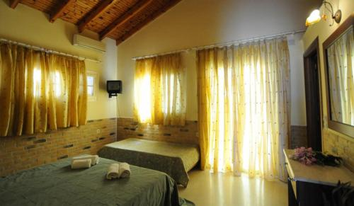 A bed or beds in a room at Kassiopi Bay