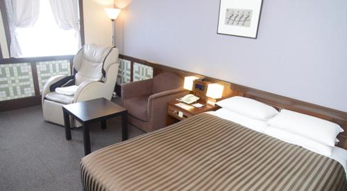 A bed or beds in a room at Hotel Clio Court Hakata
