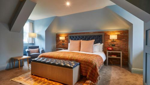 A bed or beds in a room at The Great House At Sonning
