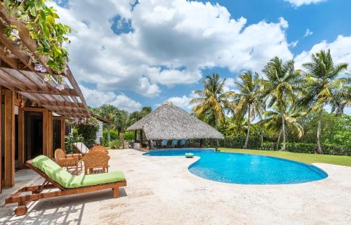 The swimming pool at or close to Unique Villa with Ocean and River Views - Staff & Golf Carts