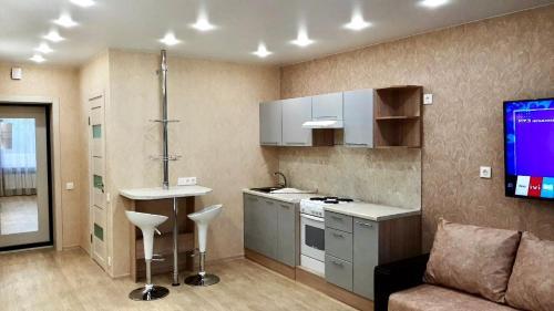A kitchen or kitchenette at Апартаменты У моря для семьи