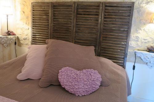 Un ou plusieurs lits dans un hébergement de l'établissement La Naomath et D-Day Kota Hébergement Insolite