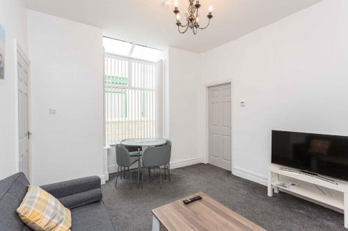 A television and/or entertainment centre at Cherry Property - Harrowside