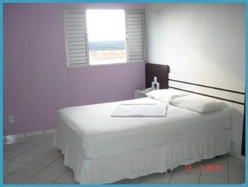 Cama ou camas em um quarto em Hotel São Vicente