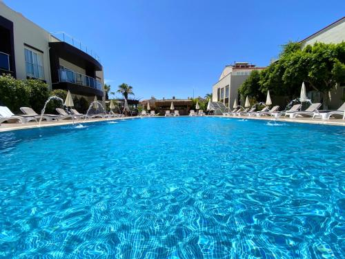 The swimming pool at or near Odyssey Residence Apartments