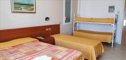 Кровать или кровати в номере Hotel Tamanco