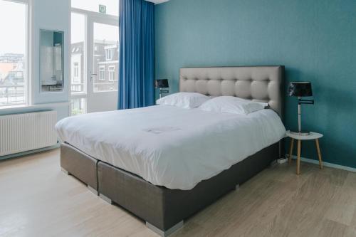 Een bed of bedden in een kamer bij Hotel Room11