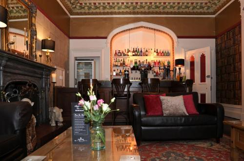 The lounge or bar area at Rosehill House Hotel