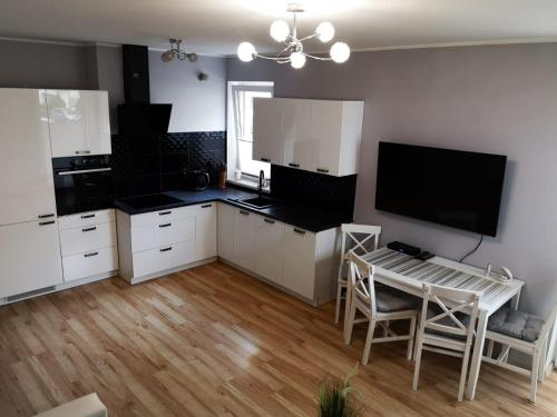 A kitchen or kitchenette at Apartament Edyta