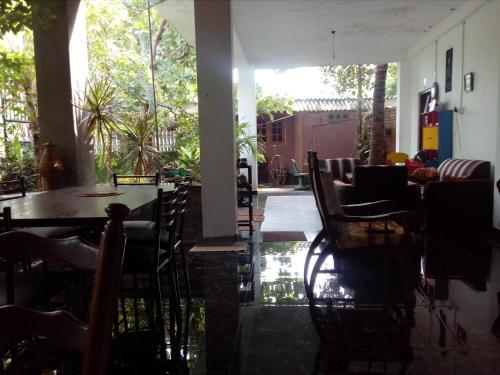 A restaurant or other place to eat at House Of Esanya