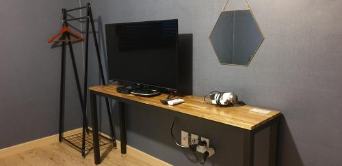 A television and/or entertainment center at Ivy Stay