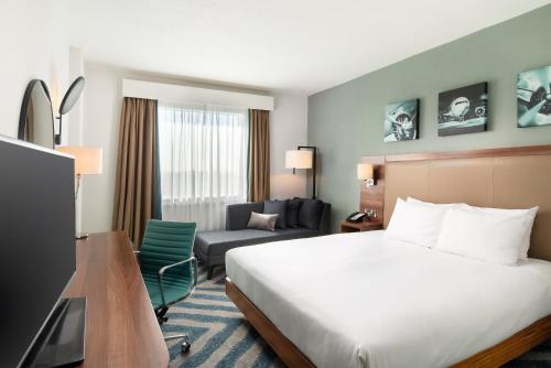 A bed or beds in a room at Hilton Garden Inn London Heathrow Airport