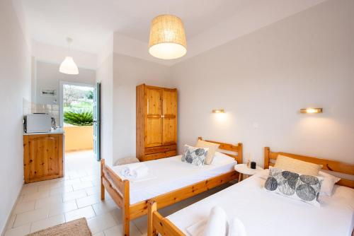 A bed or beds in a room at Little Corfu