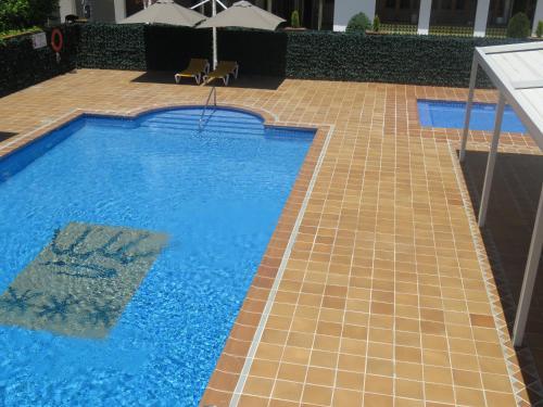 Uitzicht op het zwembad bij Hotel Santa Anna of in de buurt