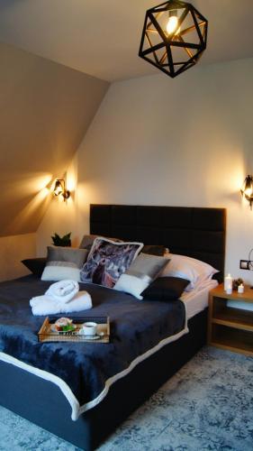 Łóżko lub łóżka w pokoju w obiekcie Skalna Chata