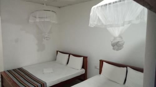 A bed or beds in a room at Umaya Holiday Home
