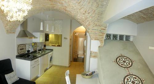 Una cocina o zona de cocina en Apartamentos Turísticos ENCANTO